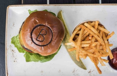 B-Lux Grill & Bar Burger and Fries. We invite you to explore our menu.